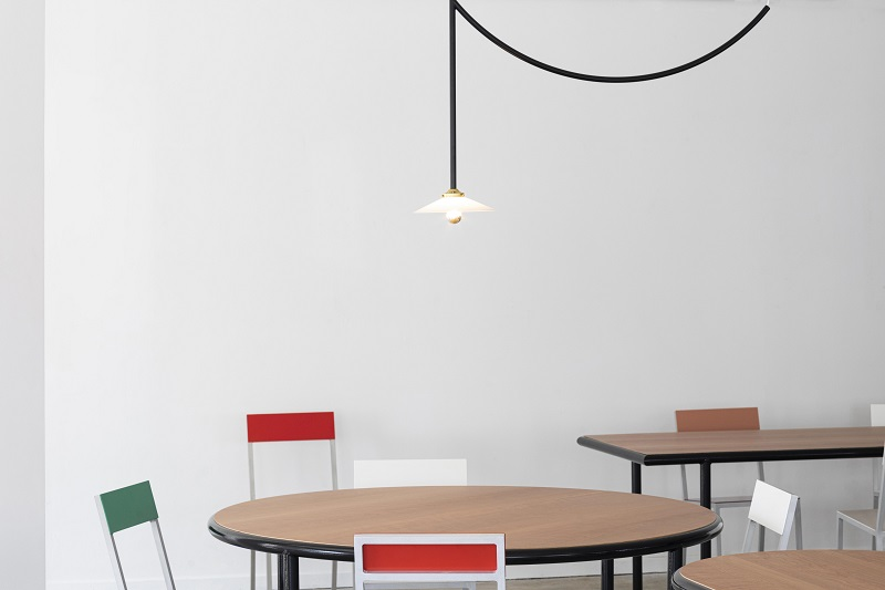 festive ceiling lamps and new wooden tables